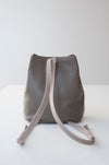 front view of the small aura in taupe pebbled leather