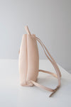 Front view of the Small Ray Backpack in beige pebbled leather