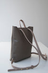 Front view of the Small Ray Backpack in taupe pebbled leather