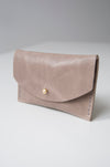front view of the glare card holder in beige veg tan leather