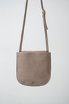 front view of the emit crossbody in taupe leather