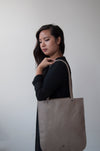 front view of the emit tote in taupe leather