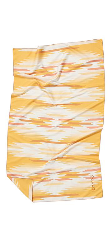 Front facing image of yellow, salmon, white and gold eco-friendly tribal pattern towel. Available for purchase on The Conservationist.