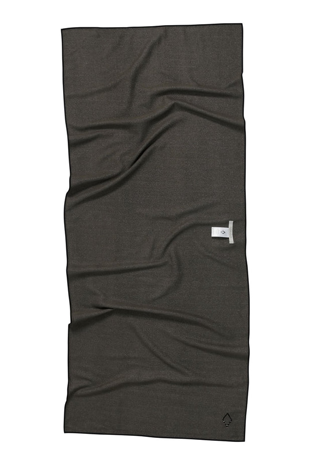 Back Facing image of Northwest Nomadix beach towel- solid grey print. Available for purchase on The Conservationist.