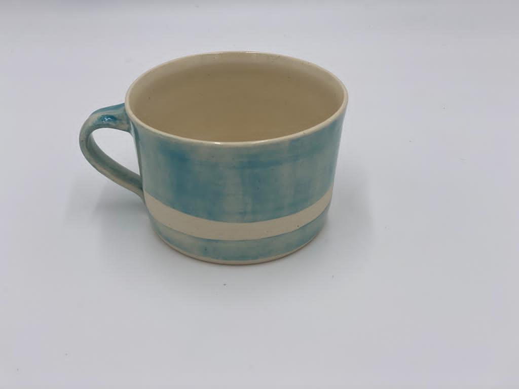 Squat style ceramic mug in a plain wash turquoise with wax line stripe