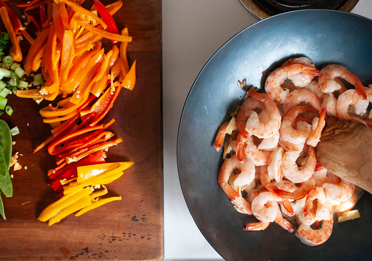 cook the shrimp in your studio weyh carbon steel wok before adding the rainbow of vegetables for this healthy and quick weeknight stir fry