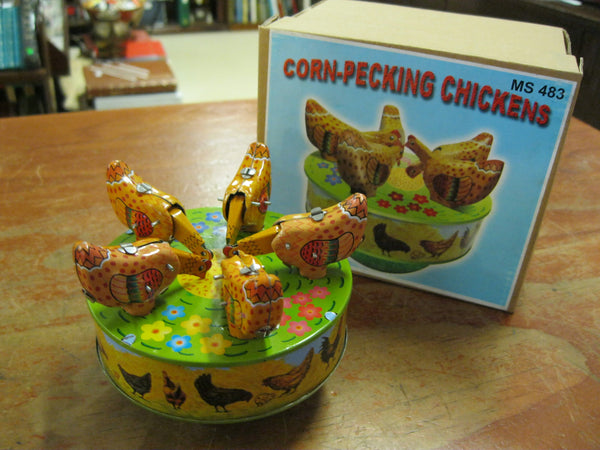 Clockwork Pecking Chickens .