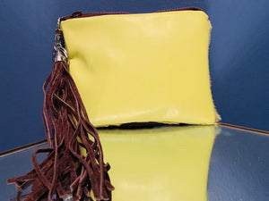 Green hair on hide fused to green leather mini clutch with brown zipper and tassel