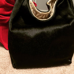 Black hair on hide fused to black leather Tote
