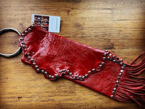 Red patent leather studded wristlet with fringe
