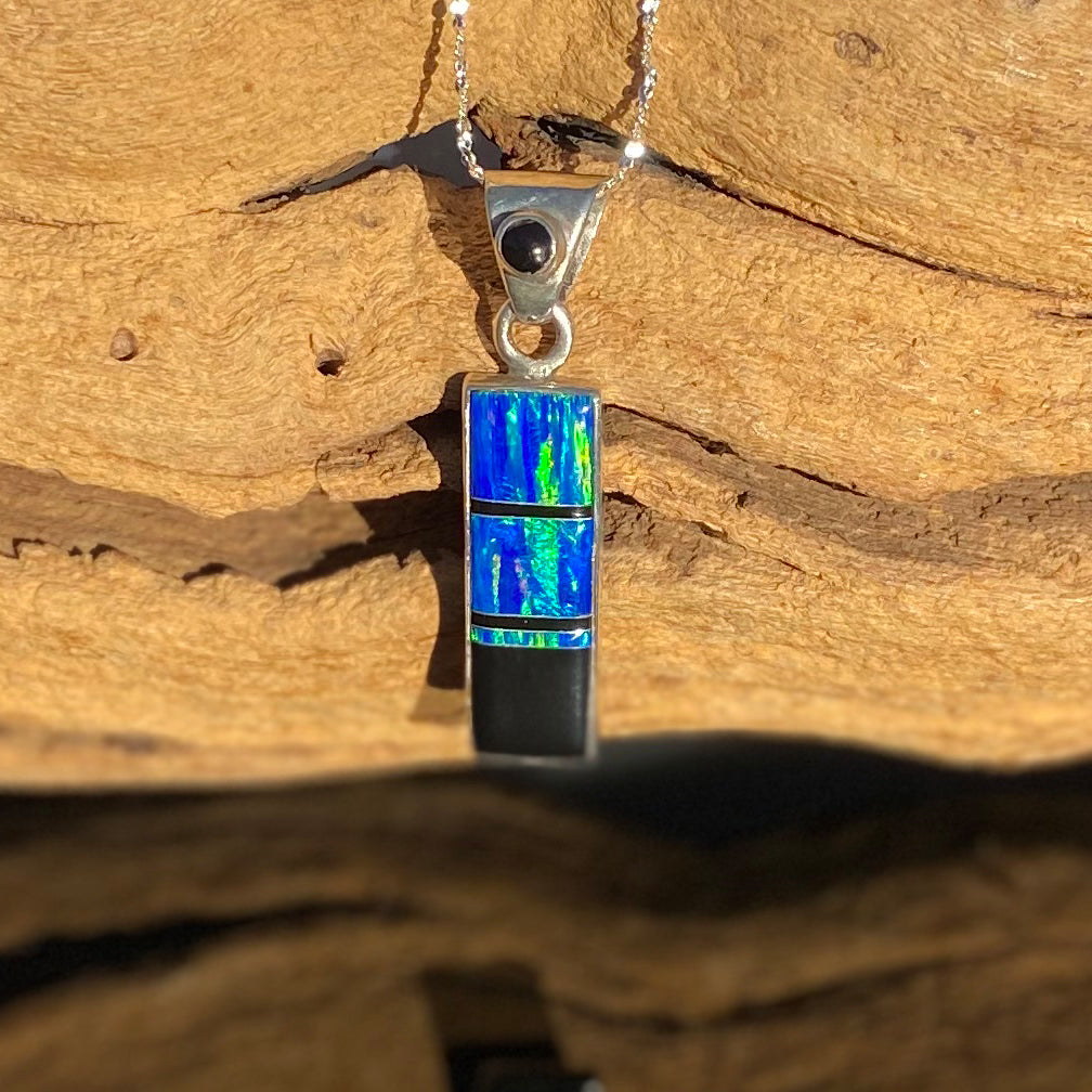 715PD -  CARIBBEAN BLUE OPAL AND BLACK PENDANT