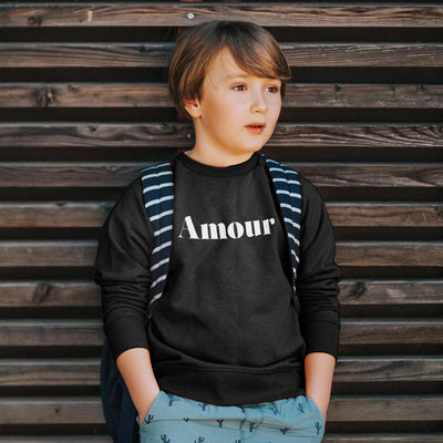 boy wearing graphic sweatshirt with text for toddlers in black