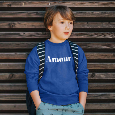 boy wearing cute hipster graphic amour sweatshirt in blue