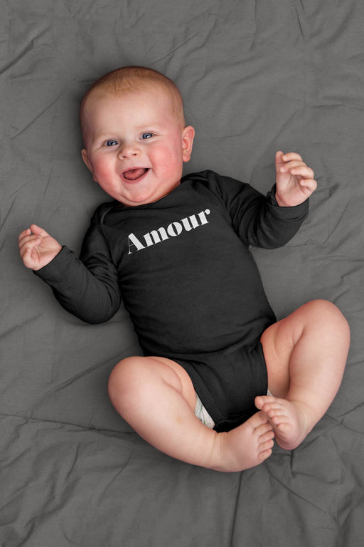 baby wearing black long sleeve Amour winter clothes