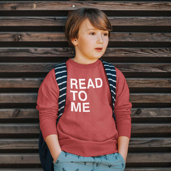 boy wearing literacy sweatshirt read to me in red