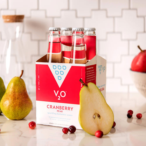 cranberry pear v2o sparkling balsamic water surrounded by pears and cranberries