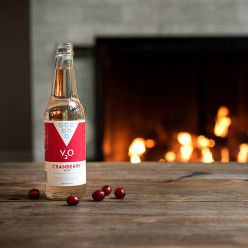 V2O lifestyle shot of Canberry Pear by the fire