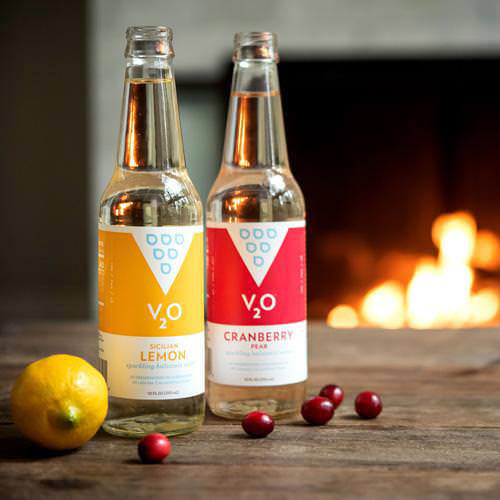 V2O lifestyle flavors sitting by the fireplace