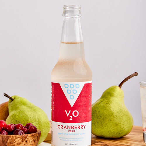 Bottle of V2O Cranberry Pear surrounded by fruit