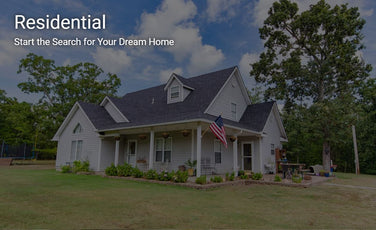 the front of a home for sale in tahlequah oklahoma