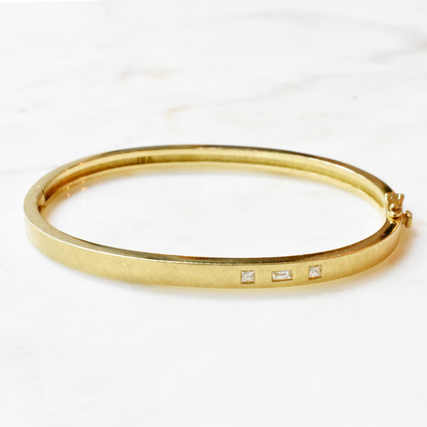 Gold Bangle with Baguette and Princess Diamond Accent