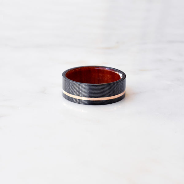 Zirconium Band with Rose Gold Inlay and Red Heart Wood Sleeve