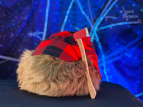 A Tribble as a lumberjack with a red checkered hat and a tiny axe.