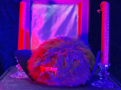 A Tribble dressed as a Vampire with candle sticks and a mirror that shows no reflection