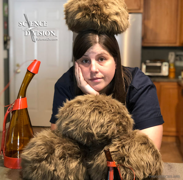 Me (Kayleigha) with a Tribble on my head and a bar covered in Tribbles and Saurian brandy bottles