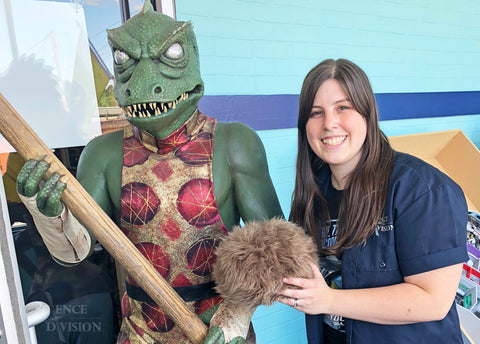 Kayleigha with a Gorn statue and a Tribble