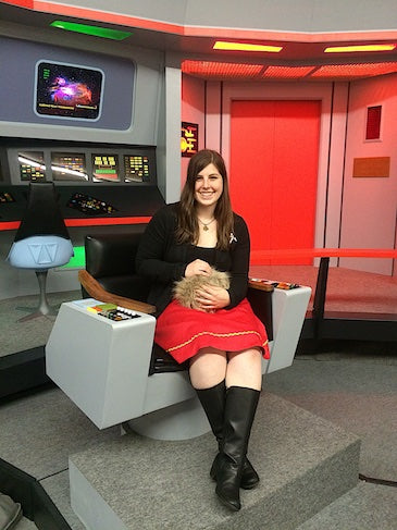 Kayleigha of Science Division holding the first prototype Star Trek Tribble on the bridge of the Enterprise