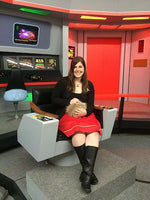 Kayleigha on the Enterprise bridge holding a Tribble