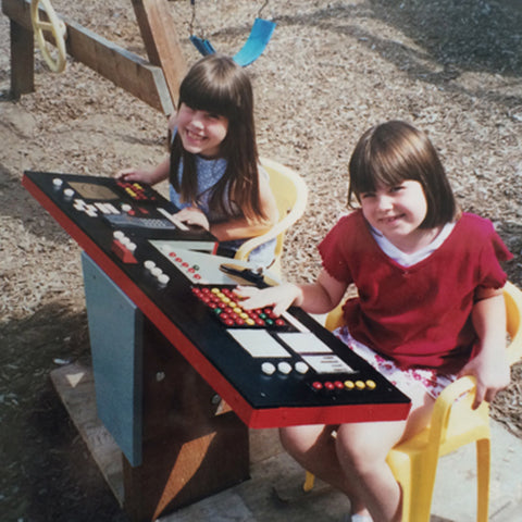Kayleigha and her sister play with a recreation of the Enterprise bridge