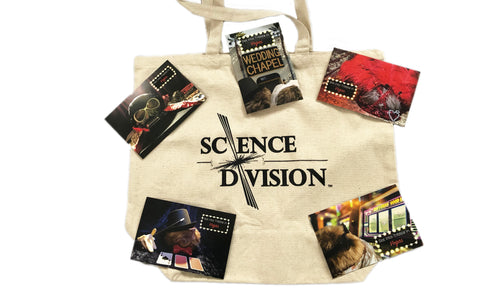 A canvas Science Division tote bag covered in postcards with photos of Tribbles in Vegas-themed cosplay outfits