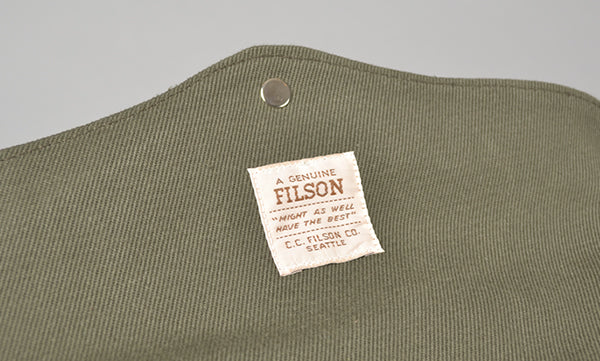filson label close up padded computer bag