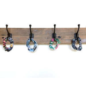 4 SHREDLY scrunchies hanging from wall hooks