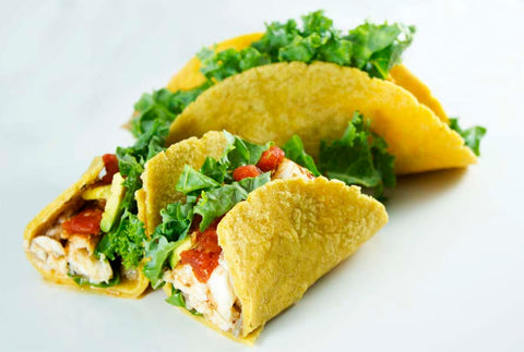 Catfish tacos loaded with kale, salsa, and avocado