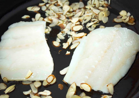 Raw cod and almond slivers