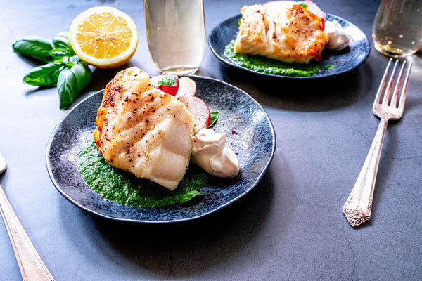 Chilean Sea bass with basil sauce on plate
