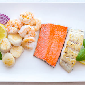 Selection of paleo fish including Wild Sockeye Salmon Fillet, Deveined shrimp, scallops and north atlantic haddock