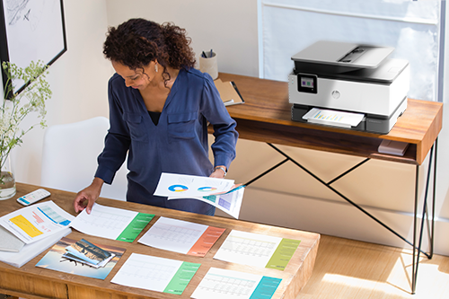 Woman printing from desktop HP home office printer
