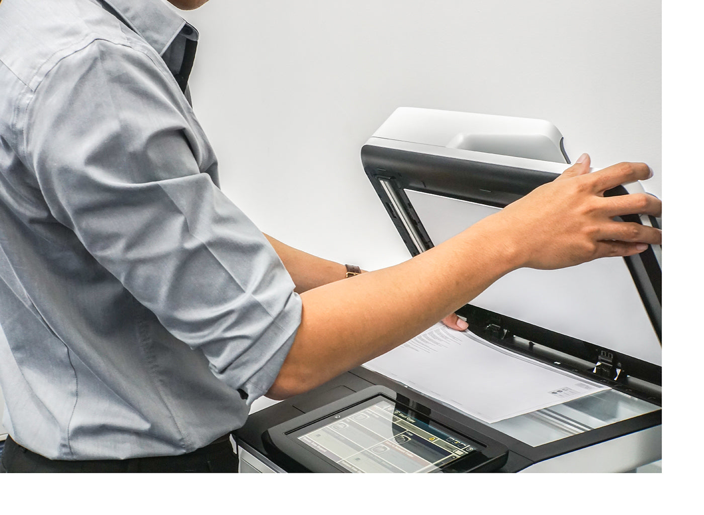 Man using office copier to scan document