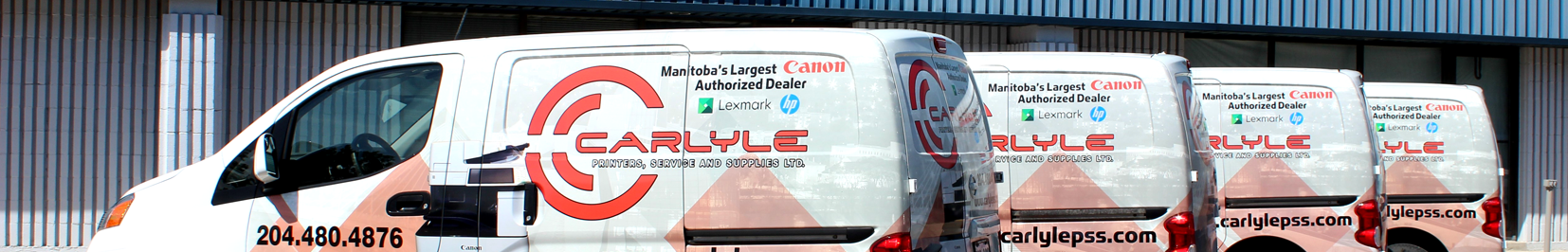Four Carlyle branded service cube vans