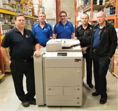 Don Prokopowich, Rick Kondra, Derek Vokey, Lloyd Norman, Jim Zilkie standing around large copier