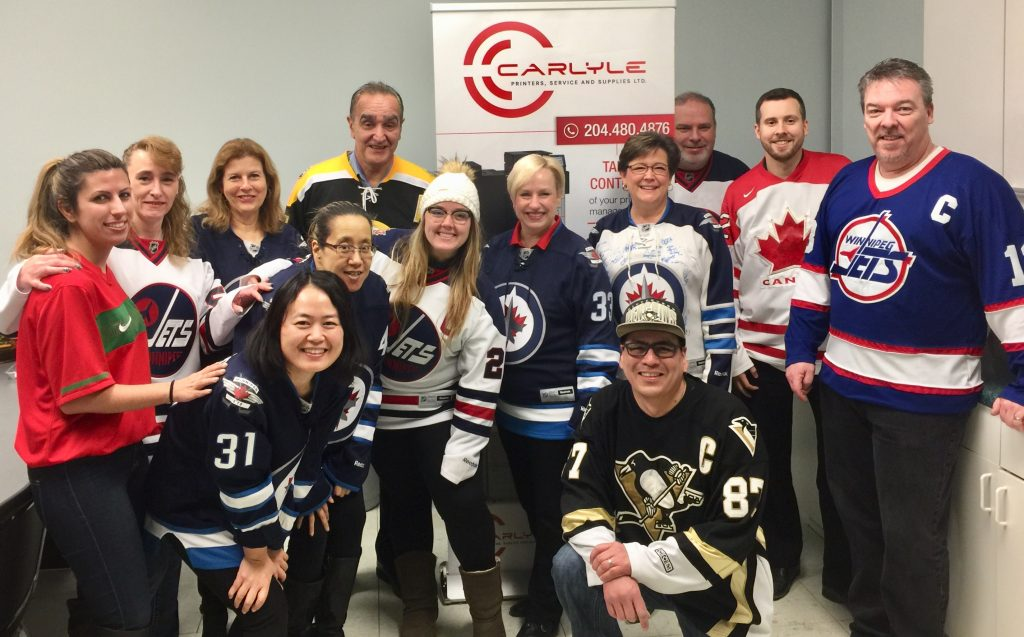 Carlyle staff in hockey jerseys in support of Humboldt Strong