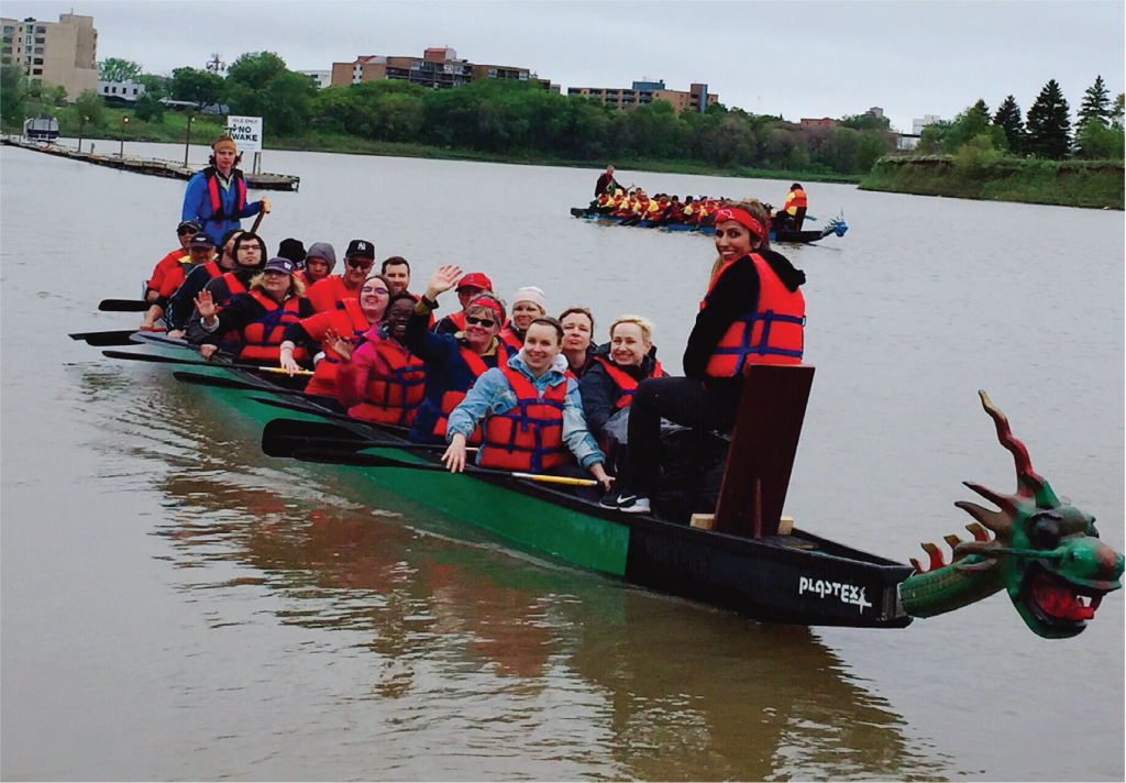 Carlyle Staff in boat as Paper Dragon Slayers community team