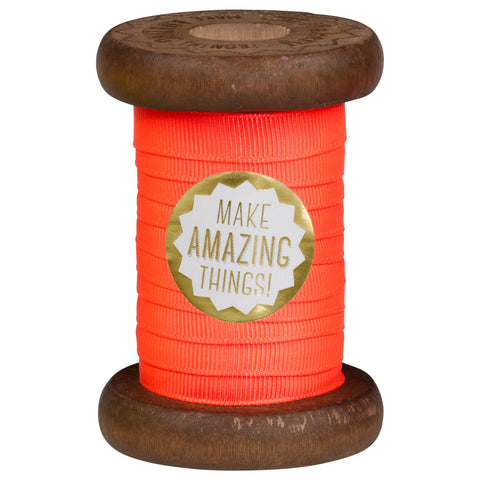 Orange Neon Ribbon on Wooden Spool