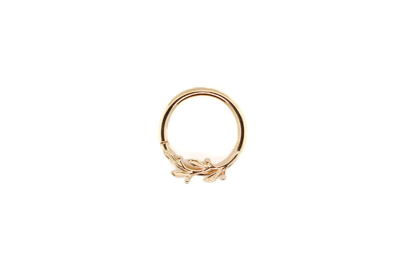 Yellow gold ring with branch of leaves curved to the right