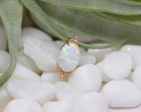 Large white opal with rose gold bead clusters