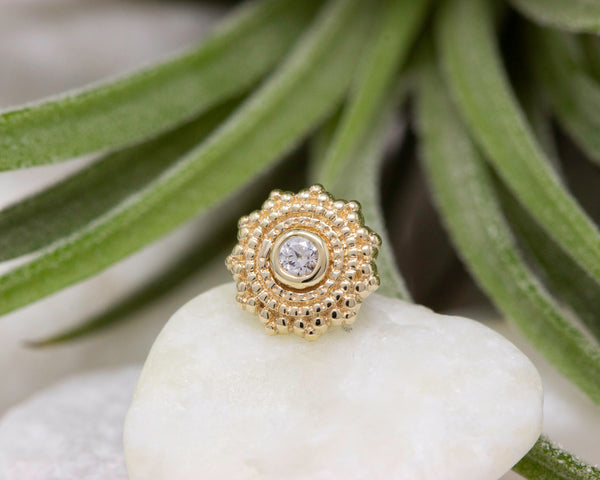 Yellow gold intricate beaded stud with CZ center